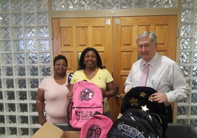 Customer Service donates school supplies to kids in need